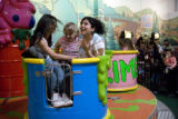 Arlette Baena, 14, (cq) Meaghan Witkowski, 12, (cq) and Karina Perez, 13, (cq) (L-R) ride the...