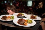 (Denver, Colo., March 1, 2008) Michelle Reynolds, with Epicurean Catering, brings out the...