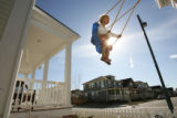 MJM126  Mia Keene, 3, is pushed in a neighbor's swing by her father, John Keene (cq) Wednesday...