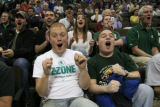 DM0477   Michigan State students Phil Parr, 20, center left, and Corey Smith, 22, center right,...