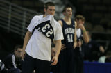DM0856   Notre Dame guard Kyle McAlarney takes a breather and watches from the sideline as the...