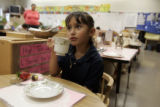 Marlen Melendez, 6, has tea with a guest in Linda Alston's kindergarten classroom at Howell K-8,...