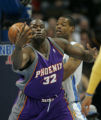 [ JOE312 ] Phoenix Suns Shaquille ONeal (32) loses the ball as he's covered by Denver Nuggets ...