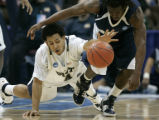 266 Pittsburgs' #4 Ronald Ramon, left, and Oral Roberts' # 10 Robert Jarvis chase a loose ball in...