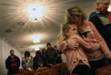 MJM278  Kallie Cathcart, 6, hugs her mother, Kammie Cathcart (cq) as they attend a service of the...