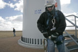 1331  Tony Welsh, a wind technician, with the Florida Power and Light Company prepares to climb a...