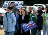 Caroline McCracken- Flesher holds a Hillary sign as she waits outside the Univ of Wyoming Sports...