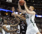 (from left) Michigan State, Raymar Morgan (cq) moves in to assist fellow teammate Drew Naymick...