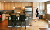 Justina Welch's kitchen, in her two-story, three-bedroom, two-and-a-half bathroom townhouse.  We...