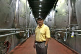 Todd Hansen (cq), Resident Brewmaster for Fort Collins Anheuser Bush, Inc., stands by some of the...