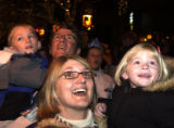 (DENVER, Colo., December 31, 2004)background, Charlie,6, and dad Matt McGrigg with wife and...