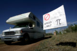 An RV drives past a speed limit sign next to the camp on at the end of the Rocky Mountain Star...