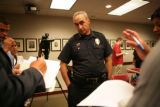 Daniel Oates, Chief of Aurora Police, talks with reporters after a news conference at the U.S....