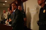 U.S. Attorney General Troy Eid speaks with memebers of the media about the Metro Gang Task Force...