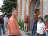 Bob Schaffer talks to Conejos County residents Thursday afternoon outside Our Lady of Guadalupe...