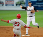 Cardinal's Jon Jay is out as Driller SS Troy Tulowitzki turns a double play at 2nd in the 5th...