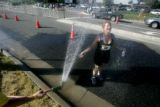 Edrea Learned, of Denver, cools off during the 5K running portion of the fifth annual Tri for the...