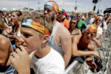 Jeff McMillen, 16, of Wichita, Kan., watches as Bret Dennen plays on the main stage during the...