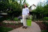 Joan Kinney at the her home takes her newly cut flowers into her air conditioned kitchen to...
