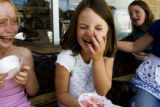 Margot Kilroy, 8, (cq) laughs with her friend Lauren Kerkhoff, 8 (cq) after she put ice cream on...