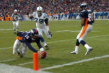 (DENVER, CO., JANUARY 02, 2005) Denver Broncos' #16, Jake Plummer, dives into the endzone ahead of...