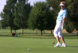 Fort Collins, CO -- Nancy Wear (cq) reacts in dismay when her short putt lips out of the hole...