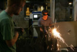 Adam Friss, 21, (cq) cuts a piece of metal as Jayson Clasquin, 21, (cq) helps him. The two were...