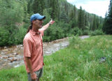 dentry 8) Five Rivers Trout Unlimited president Ty Churchwell stands at upper Hermosa Creek, near...