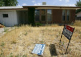 An abandoned home for sale in the Montbello neighborhood which has been hit hard by the...