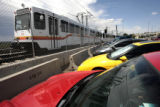 Cars parked by commuters, Tuesday afternoon, July 22, 2008, at the Park- n-Ride lot at I-25 and...