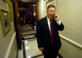 Doug Lamborn takes a phone call after he cast his final vote for the day at the United States...