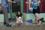 Jess Steinitz, 24, (cq) ties her rollerskates as  Carrie Jackson, 27, (cq) hands Joe Cooper, 25,...