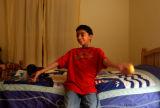 (Castle Rock, CO., SHOT 12/18/04)   Philip,9,  in his bed room at his home in Castle Pines on his...