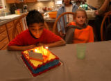(Castle Rock, CO., SHOT 12/18/04)   Philip (left), 9, blows candles out at his ninth birthday...