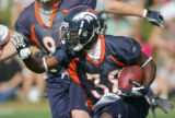 Anthony Aldridge runs at Broncos training camp at Dove Valley in Centennial, Colo., on Thursday,...