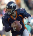 (DENVER, CO., DECEMBER 12, 2004)  Denver Broncos #16, Jake Plummer, rolls out for a pass against...