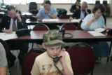 Liam Ransom, 11, (cq) of Highlands Ranch makes phone calls at John McCain's campaign office....