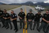 1738  More than two dozen Summit County law enforcement officers stand at the east gate of the...