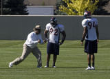 Defensive line coach Jacob Burney (cq) coaches Elvis Dumervil, 92 (cq) defensive tackle and Jarvis...