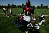#19-Eddie Royal, wide receiver (cq) walks off the field after The Denver Broncos work out Sunday...