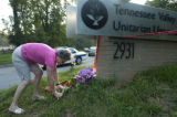 Sunday, July 27, 2008  Anna Fraser (cq) of Knoxville lays flowers near the front driveway of the...