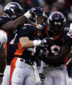 (December 12, 2004) -- Denver Broncos safety John Lynch, #47,  celebrates with teammates Monsanto...