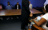 (PG286) People get settled at the start of an ACLU of Denver press conference on Monday, August...