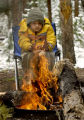 (FRISCO, Colorado... May 30, 2004) Jerimiah (cq)  Tutor,12 from Broomfield warms himself on a...