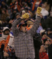 (December 12, 2004) -- Denver Broncos fans celebrate their team's exploits against the Miami...