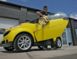 Mark Riopelle (cq) gets a Smat Car ready for a customers pick-up, Monday afternoon, July 28, 2008,...