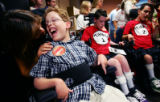 Lori Parker (cq), soothes her son Andersen Parker (cq), 11, both of Aurora, after they helped...