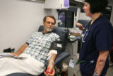 Rep. John Soper (cq) D-Adams County, donates blood with the help of Stormi Stewart  of Bonfils...