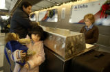 (DENVER, Colo., January 3, 2005) Activity at the Delta counter at Denver International Airport. ...