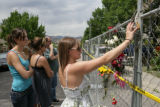 Danielle Jacoby, 19 (cq) reaches up to touch a pair of googles someone had possibly left for...